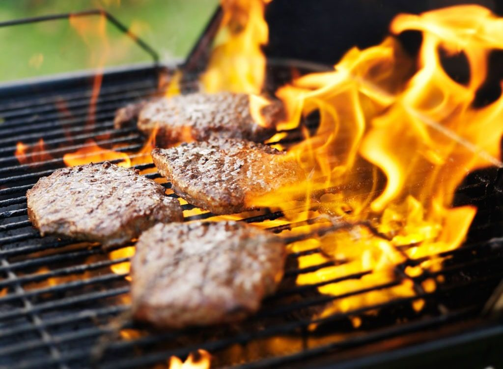 Burgers on flaming grill