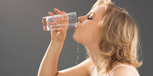 woman is drinking water